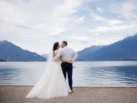 Married couple holding each near at the lake
