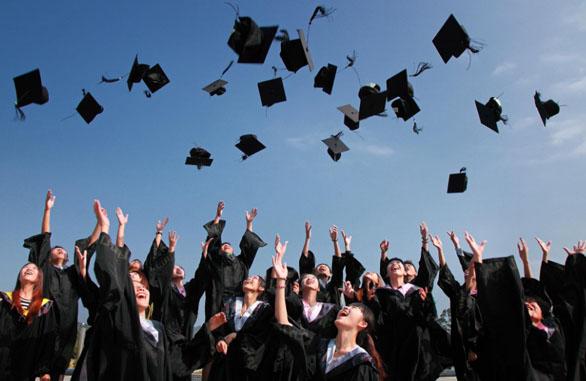 Students throwing academic cap