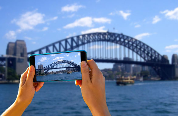 Australian tourist taking picture of Harbour Bridge